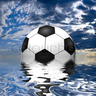Soccer ball reflected in water over the blue sky with clouds
