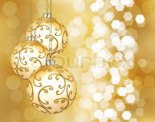 Three beautiful golden christmas balls on a golden background