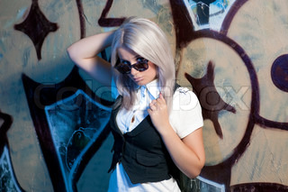 blond woman in front of grafitti