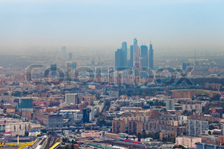 above view on Moscow City and cityscape in smog autumn day, Russia