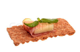 Melon with Parma ham on a green plate | Stock Photo | Colourbox