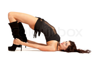 Sexy woman practicing yoga Wears beautiful boots
