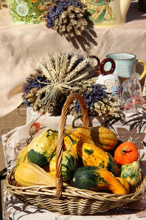 Variation of ripe farm autumn vegetables and dried handmade flower bouquets