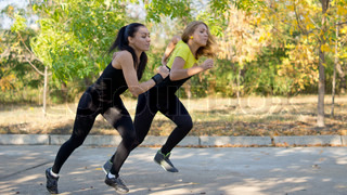 Two women spring into action during training