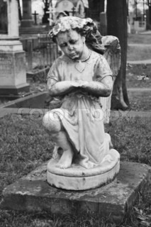Statue of angel adorns the grave