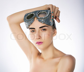 Pretty young naked woman fashion model in sport goggles