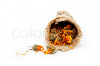 Herbs Dried calendula or pot marigold flowers in a linen package isolated on white background