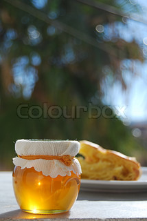 honey jar with pastry