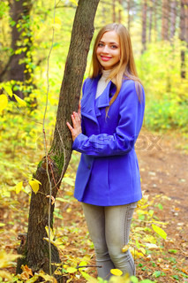 Portrait of a beautiful girl in autumn forest