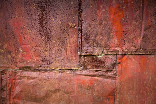 Bright red rusted metal wall detailed grunge background texture