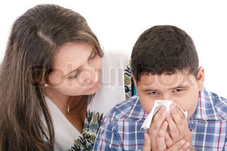 Child blowing nose Child with tissue catarrh or allergy