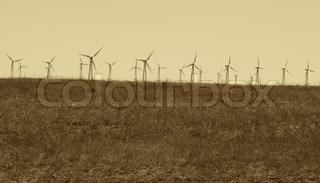 wind turbines at countryside in sepia