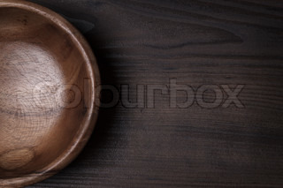 wooden salad bowl on the brown table