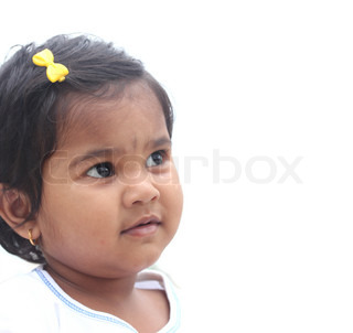 Photo of pretty and happy indian girl child The picture can be used to show the baby day dreaming or the toddler imagining something or as a child with a vision, etc The child is of pre-school age