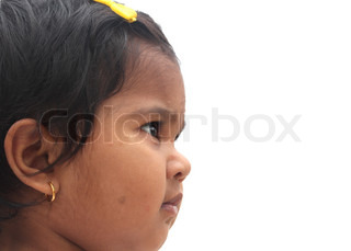 Photo of beautiful and charming happy indian girl child The picture can be used to show the baby dreaming or the toddler imagining or as a visionary child, etc The child is of pre-school age