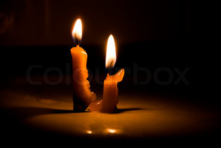 old candle on the black background