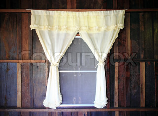 white drape and old wooden window