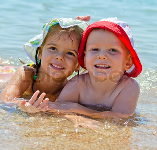 Two young children swimming