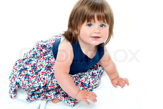 Adorable 10 months old baby girl crawling