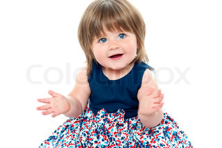Chubby little toddler wearing dotted blue frock