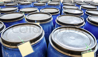 blue plastic industrial barrels for storage of chemicals in factory