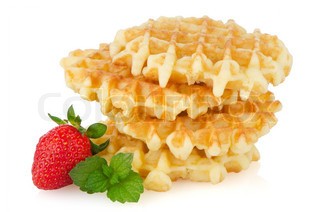 Waffles and strawberry isolated on white background
