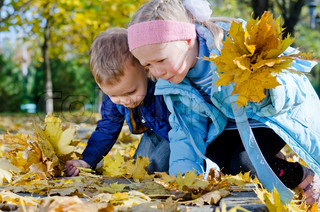 Children collecting autumn leaves