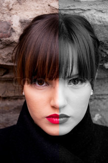 Woman face with half in color - half in black and white