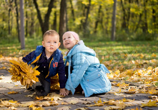 Two Young Children Playing in a Park