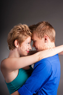 Young beautiful couple in the studio