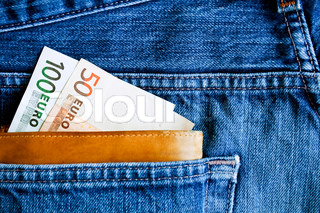 Wallet with euros in jeans pocket