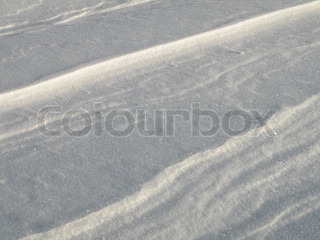 close up of snow covering the surface with pattern