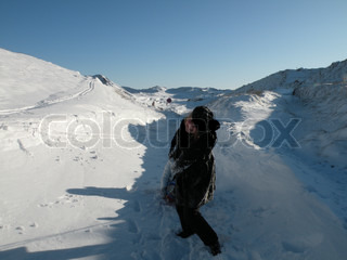 Girl pulling a sledge slay through much snow