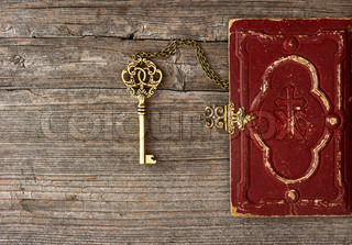 key and old bible book cover
