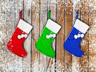Christmas socks hanging on a wooden wall