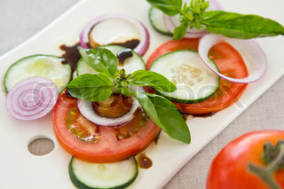 Tomato with cucumber,basil and onion with balsamic sauce | Stock Photo ...