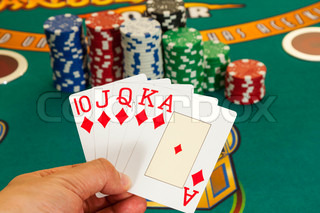 Royal flush cards holding in hand