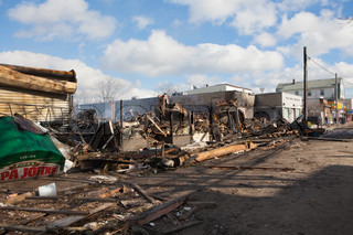 NEW YORK - October 31: Homes sit smoldering after Hurricane Sandy on October 30 2012 in the Far Rockaway area  Over 50 homes were reportedly destroyed in a fire during the storm on October 30 2012 in New York City NY