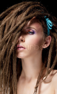 Dreadlocks Fashion hairstyle with dreads - beauty woman face