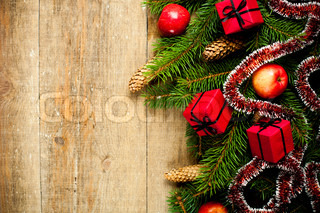 fir tree with pinecones, apples and decorations