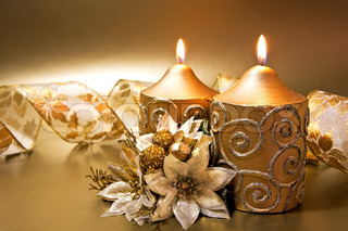 Christmas decoration with candles and ribbon