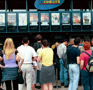 Rear of people standing outside a multiplex