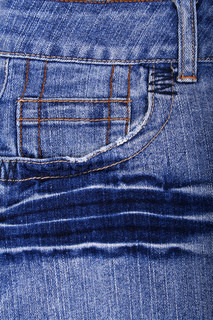Blue jeans fabric with pocket as background