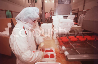 People packing meat at food industry