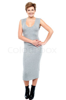 Glamorous charming woman in long grey dress