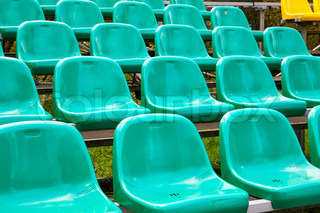 Rows of green plastic seats