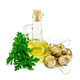 Several of tubers of Jerusalem artichoke with parsley and a bottle of vegetable oil isolated on white background