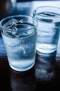 Two Glasses of Water on Table