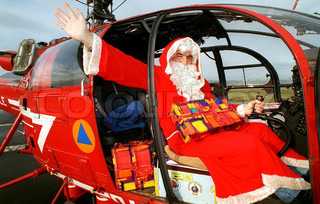 Santa Claus boarding a helicopter