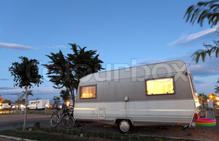 Caravan on a camping site at dusk